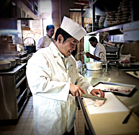 Chef Yamada prepping D'Artagnan duck breast in the open kitchen