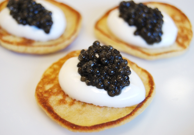 Buttery blini make a tasty cushion for our French ossetra caviar.